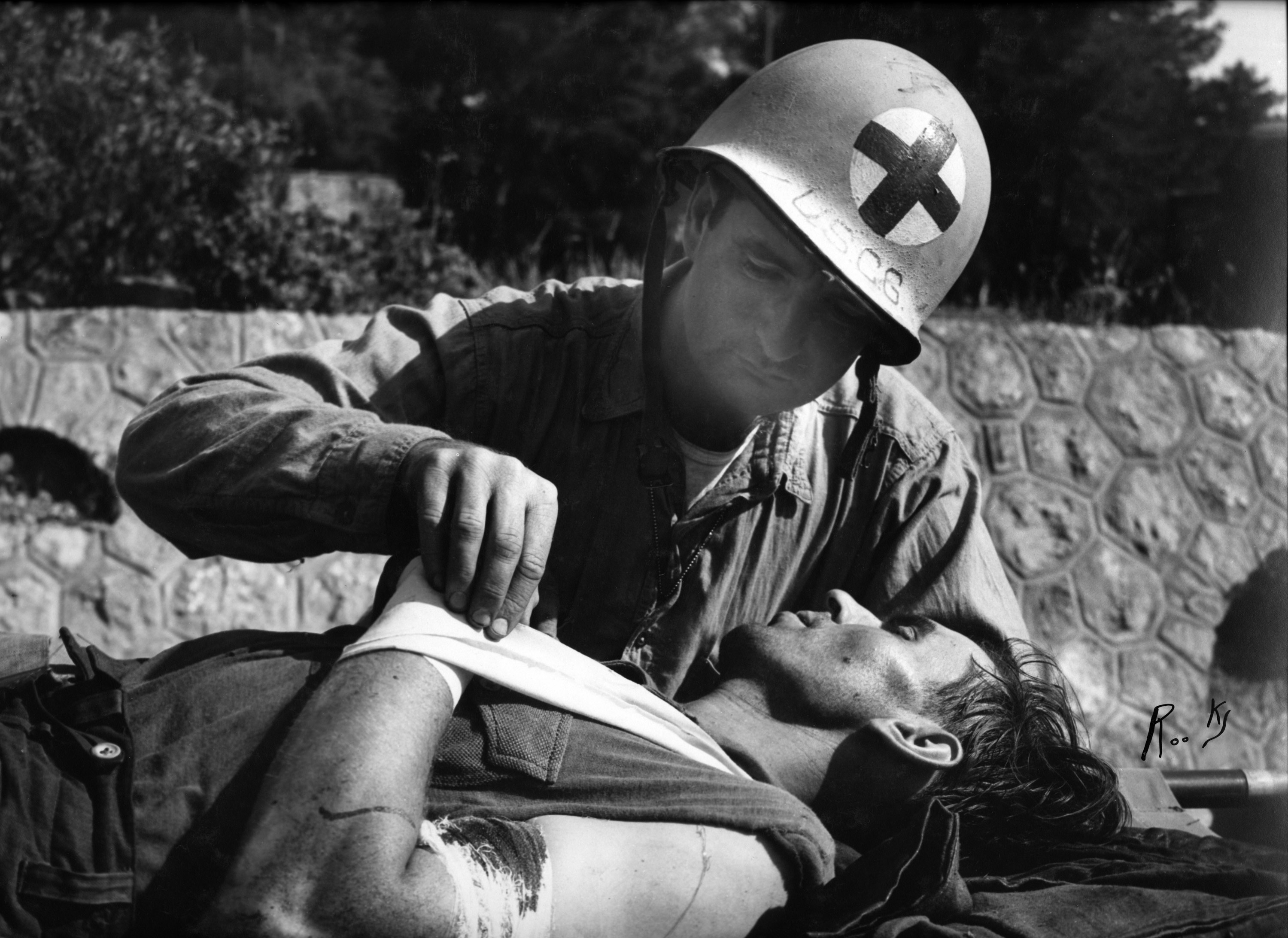 Ph. M. Baker treating wounded German captive
